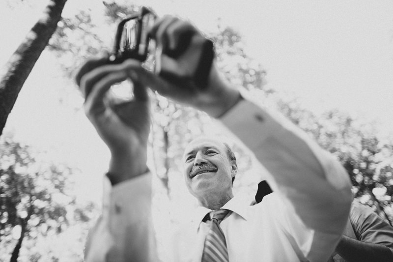 dad taking photos with iphone