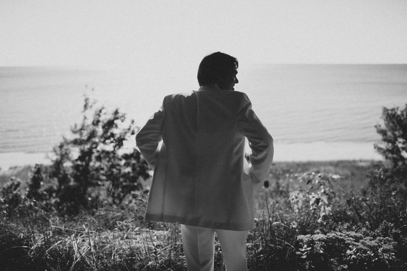 groom overlooking cliff