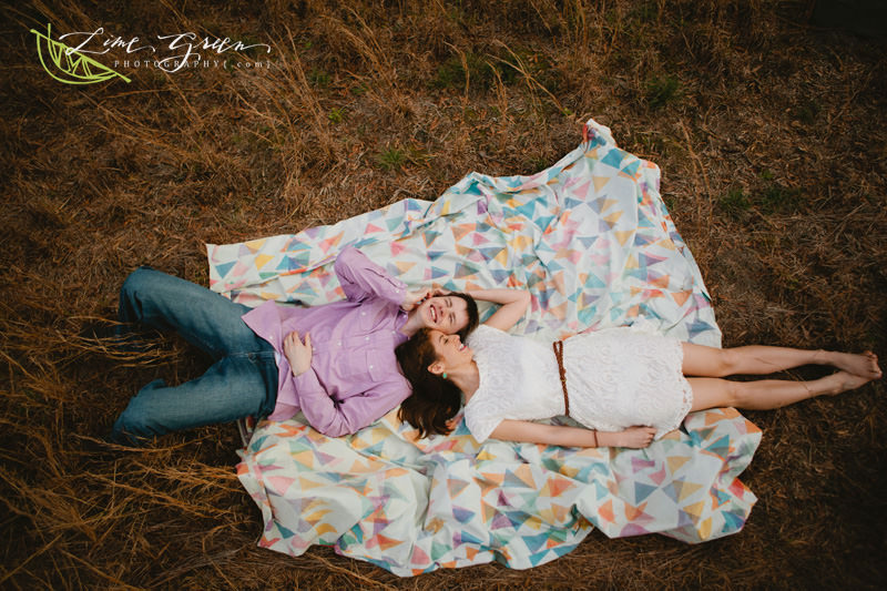blanket in a field engagement pictures