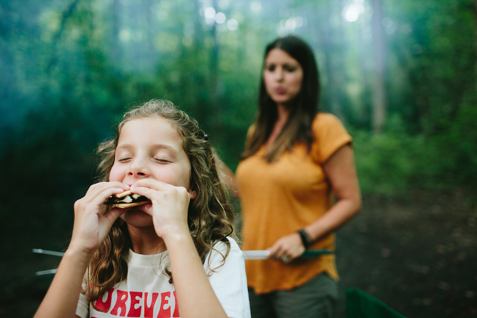 girl eating s'mores