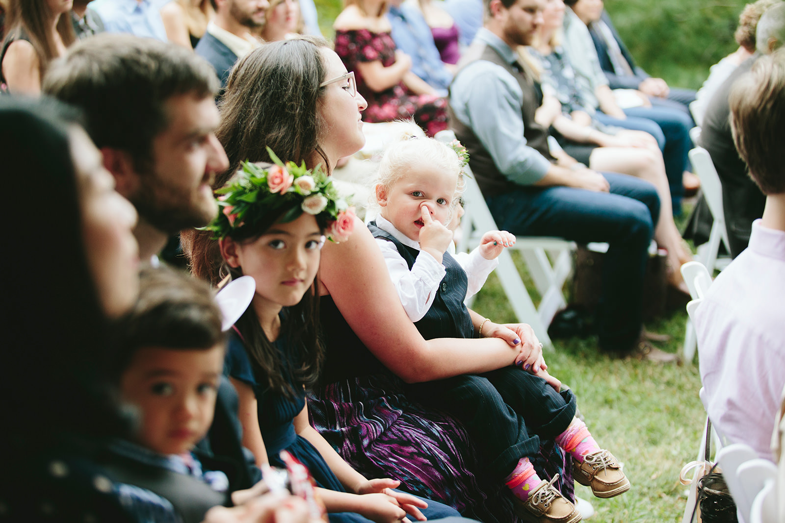 kid picking nose at wedding