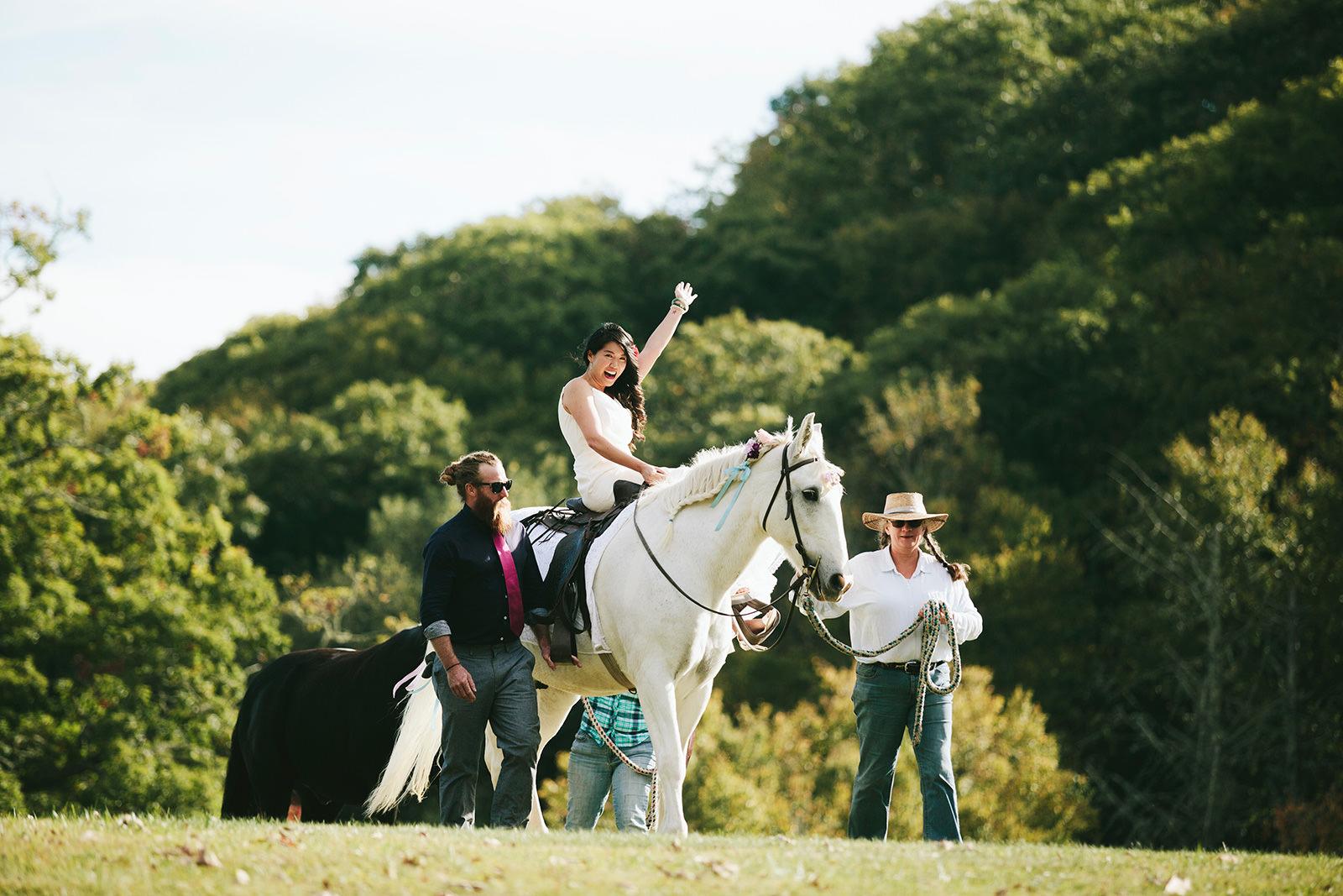 bride riding a horse wedding photo