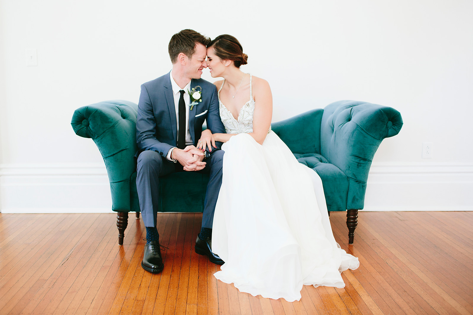 teal couch wedding rental