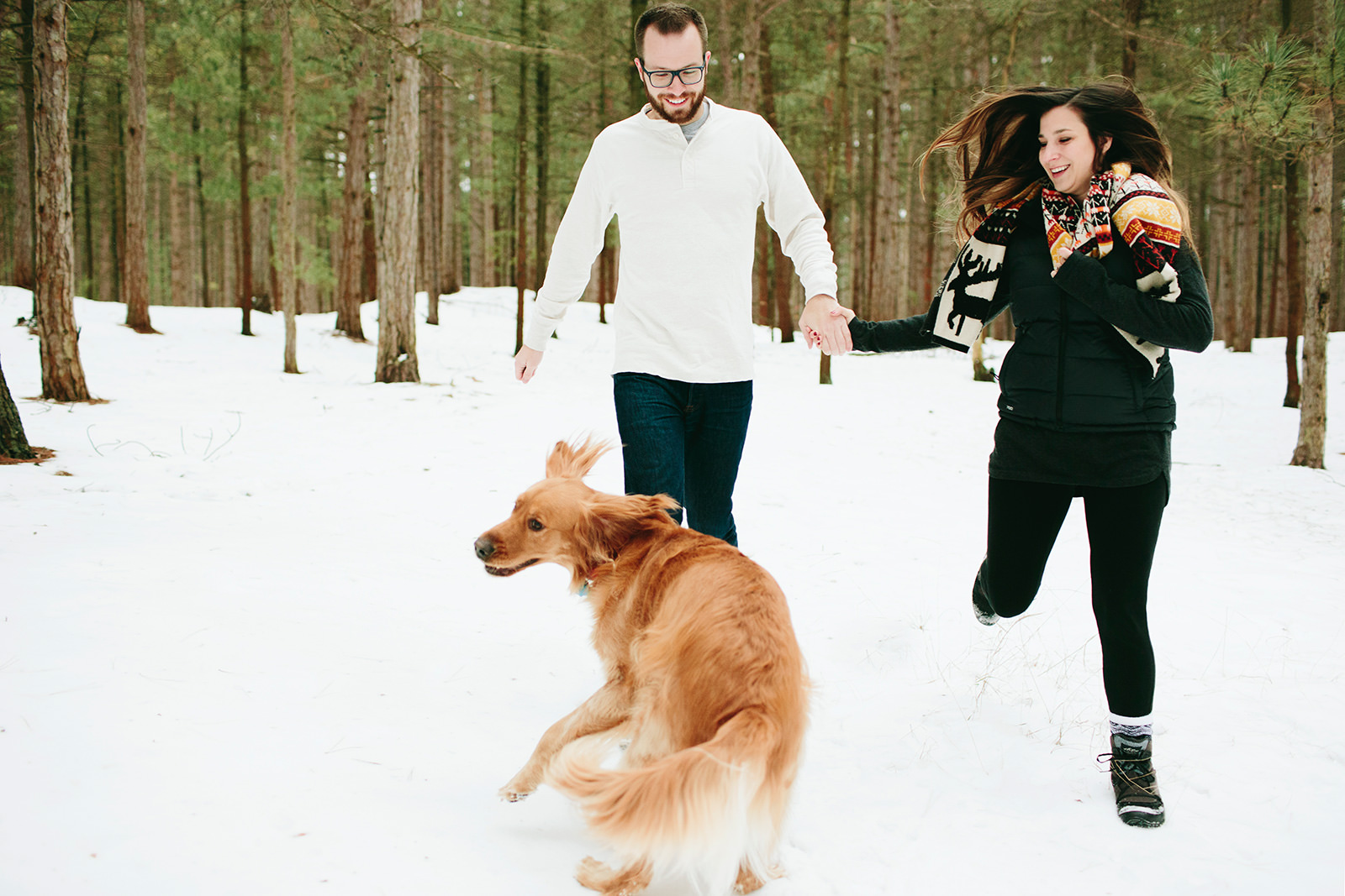 engagement photos with a golden retriever