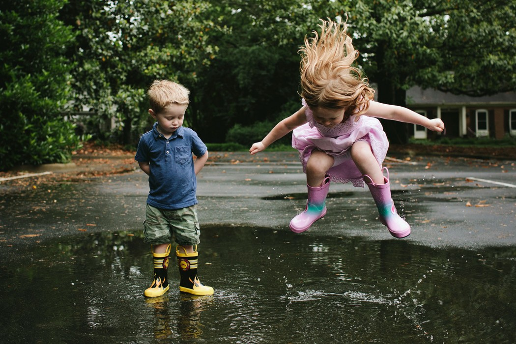 kids splashing in puddles