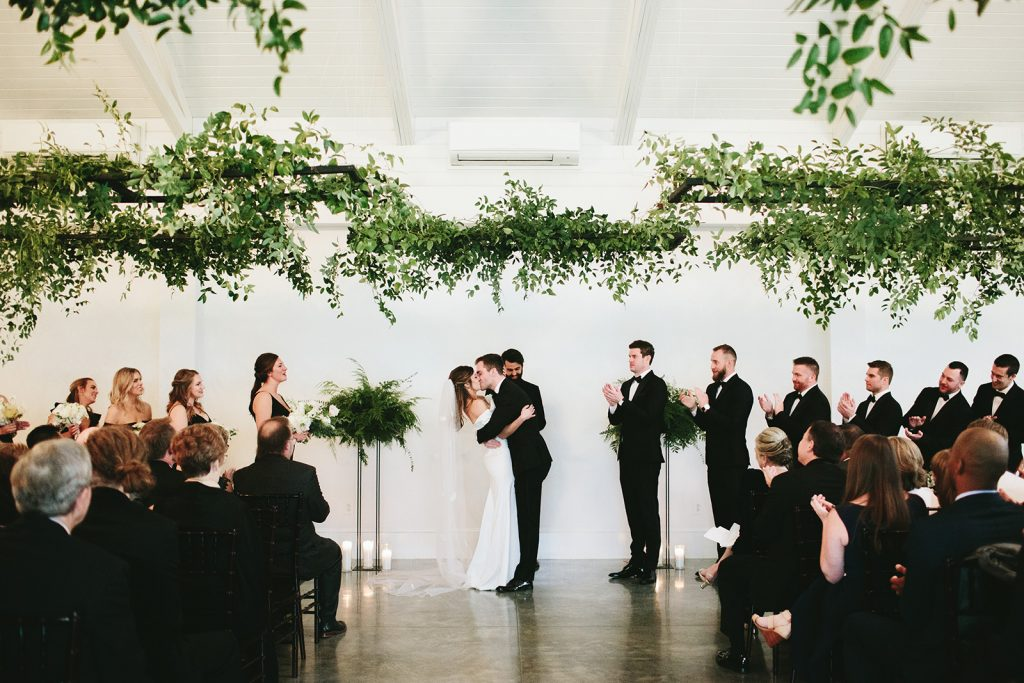 hanging ferns and greenery wedding